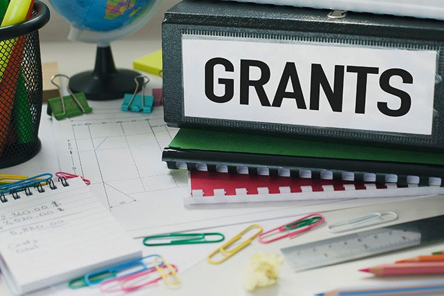 Desk with Grant Paperwork and Office Supplies