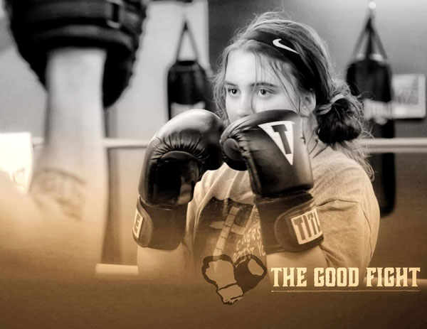 Teenage girl during boxing practice at The Good Fight